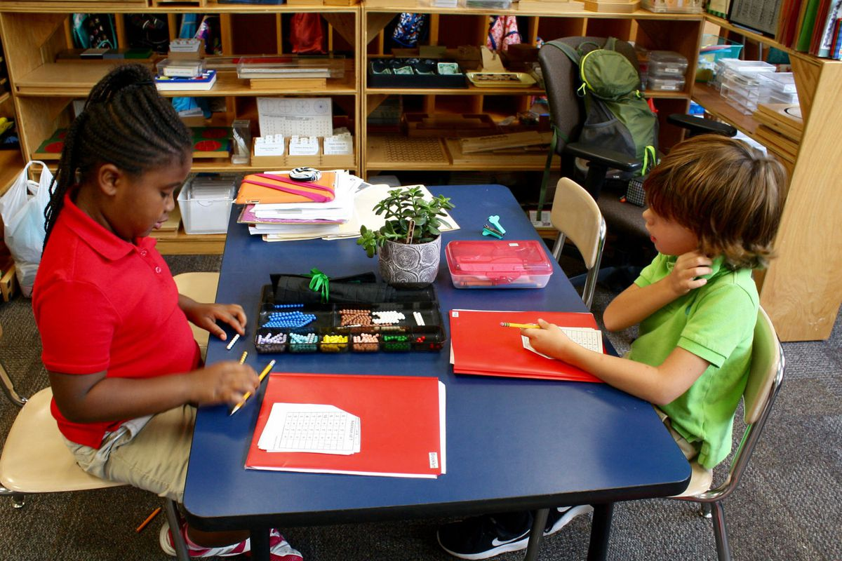 Students in IPS School 91's multi-age first-, second- and third-grade classroom work on math activities. The school is one of the district's high-performing integrated Montessori magnets that is attracting families from outside district boundaries.