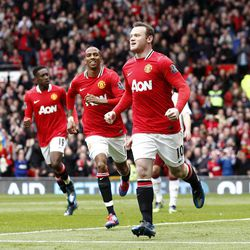 Manchester United's Wayne Rooney, right, celebrates after scoring a penalty against Aston Villa during their English Premier League soccer match at Old Trafford Stadium, Manchester, England, Sunday, April 15, 2012.