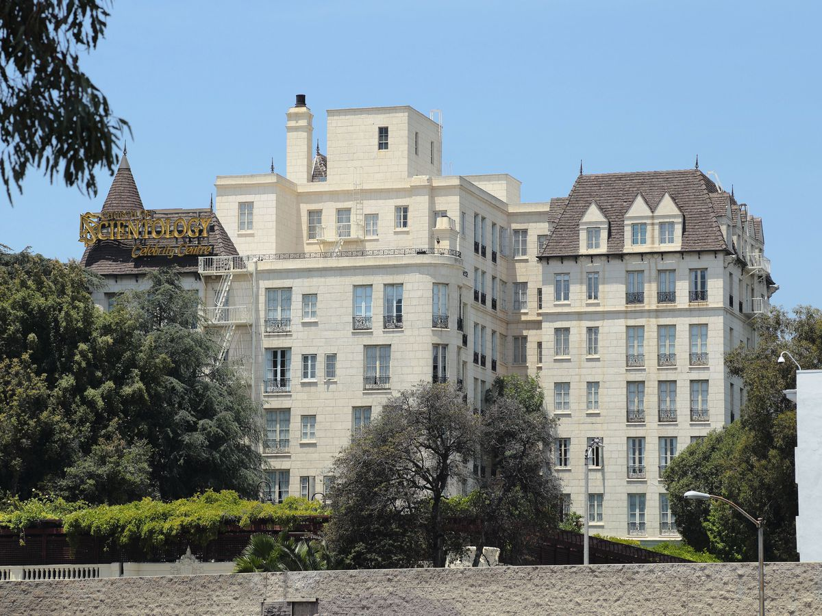 The exterior of the scientology celebrity center, Chateau Elysee in Hollywood, California. The facade is white with a brown roof and many windows.