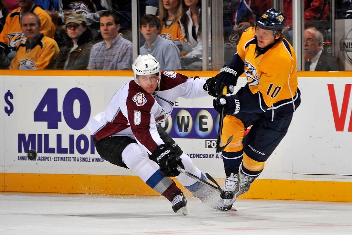NASHVILLE, TN - MARCH 08:  Martin Erat #10 of the Nashville Predators shoots the puck past Jan Hejda #8 of the Colorado Avalanche at Bridgestone Arena on March 8, 2012 in Nashville, Tennessee.  (Photo by Frederick Breedon/Getty Images)