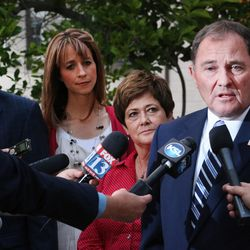 Gov. Gary Herbert talks with media outside the Governor's Mansion in Salt Lake City on Tuesday, June 28, 2016. With Herbert are his wife, Jeanette, Lt. Gov. Spencer Cox and Cox's wife, Abby. Herbert defeated Jonathan Johnson in Tuesday's GOP primary.