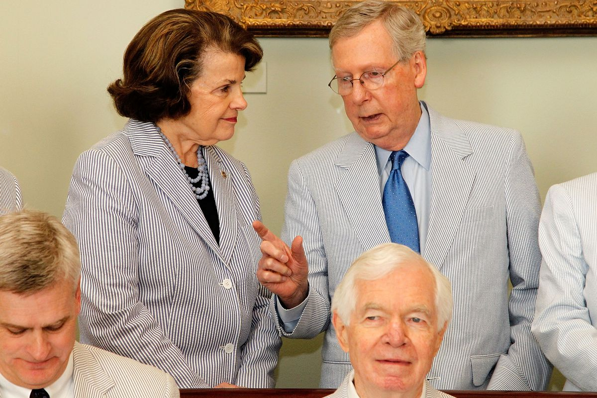 Sen. Dianne Feinstein (L) (D-CA) talks with Senate Majority Leader Mitch McConnell (R-KY) before a photo op to celebrate National Seersucker Day at the US Capitol Building on June 11, 2015, in Washington, DC.