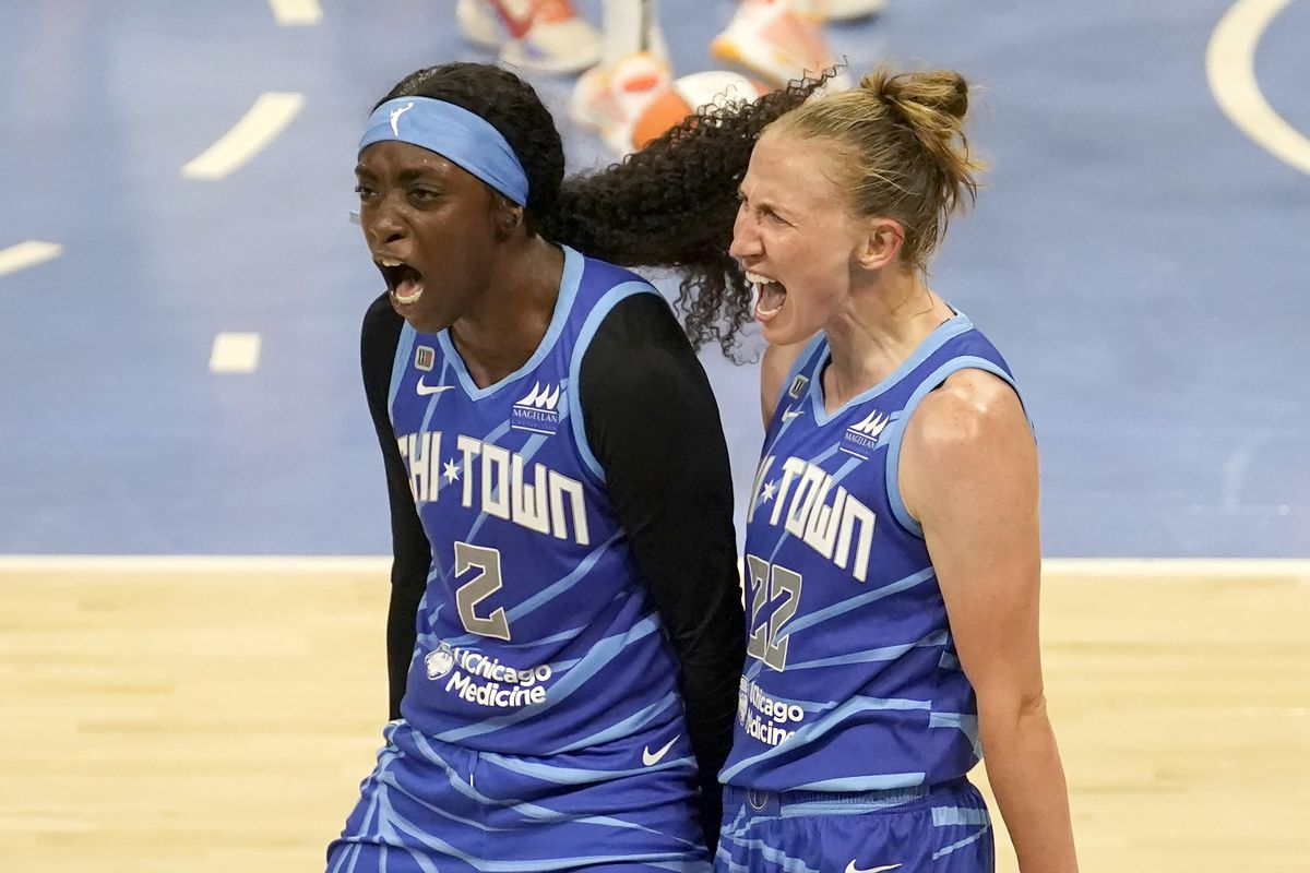 Chicago Sky's Kahleah Copper (2) celebrates with Courtney Vandersloot after Vandersloot was fouled and scored in the act of shooting during the second half of a WNBA basketball game against the Connecticut Sun Thursday, June 17, 2021, in Chicago. The Sky won 81-75. (AP Photo/Charles Rex Arbogast) ORG XMIT: ILCA108