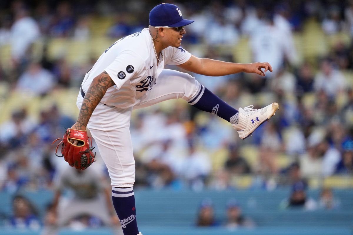 Los Angeles Dodgers starting pitcher Julio Urias (7) follows through on a pitch against the Milwaukee Brewers in the first inning at Dodger Stadium.