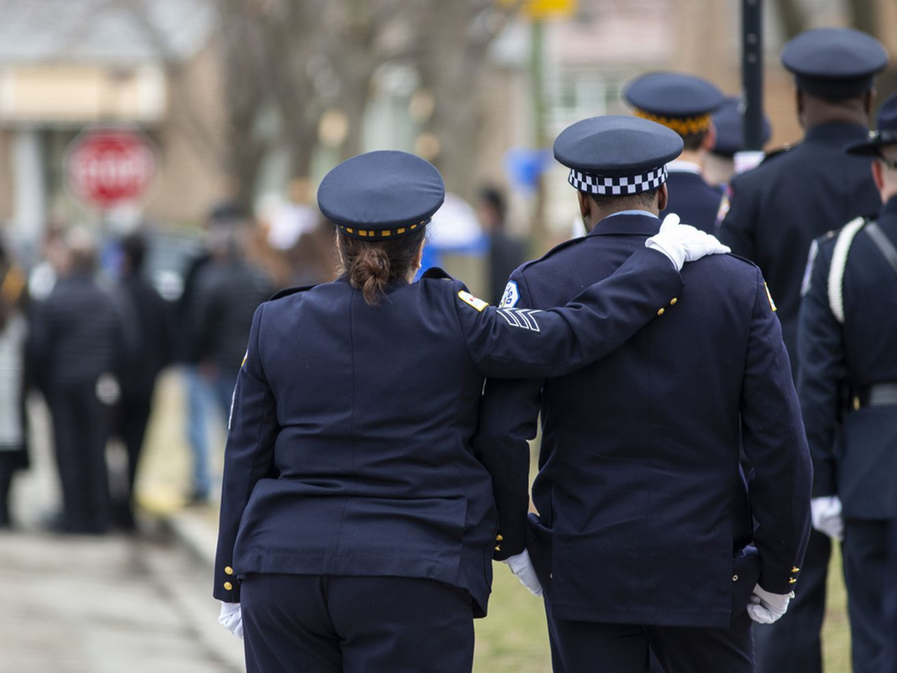 Police officers comfort each other at the funeral for Chicago Police Officer John P. Rivera.   Ashlee Rezin/Sun-Times