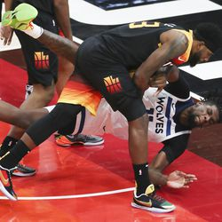 Utah Jazz forward Royce O'Neale (23) and Minnesota Timberwolves center Naz Reid (11) fight over the ball in Salt Lake City on Saturday, Dec. 26, 2020.
