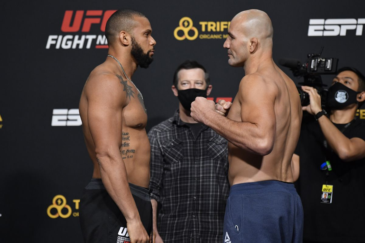 Opponents Thiago Santos of Brazil and Glover Teixeira of Brazil face off during the UFC weigh-in at UFC APEX on November 06, 2020 in Las Vegas, Nevada.