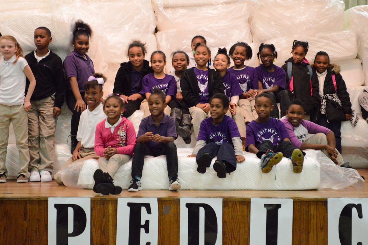 Students at Whitney Achievement Elementary School receive their new mattresses during an assembly at the Memphis school.