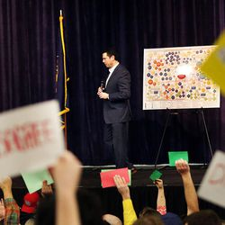 Rep. Jason Chaffetz listens to questions as many of those in attendance hold signs and yell during a town hall meeting at Brighton High School in Cottonwood Heights on Thursday, Feb. 9, 2017.