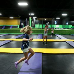 Julia Rossiter, Emory King and Allison King, left to right, play on trampolines at Get Air Salt Lake in Murray on Friday, July 29, 2016.