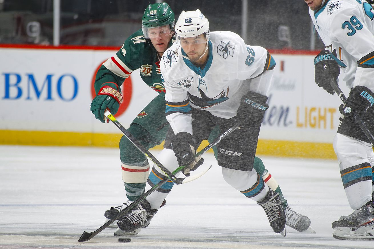 Kevin Labanc #62 of the San Jose Sharks skates with the puck while Ryan Suter #20 of the Minnesota Wild defends during the game at the Xcel Energy Center on January 24, 2021 in Saint Paul, Minnesota.