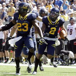 California defensive back Marc Anthony (2) follows the block of Josh Hill (23) after intercepting a pass from Southern Utah during the second half of an NCAA college football game, Saturday, Sept. 8, 2012, in Berkeley, Calif. Anthony ran the ball back for a touchdown. (AP Photo/Ben Margot)