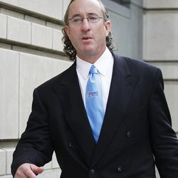FILE - In this May 25, 2010, file photo, Brian McNamee, former personal trainer for Roger Clemens, leaves Federal court in Washington, after a grand jury appearance.  The Justice Department, embarrassed by an error that caused a mistrial of Clemens last year, has added more prosecutors in hopes of containing any missteps as it seeks to convict the famed pitcher of lying to Congress when he said he never used performance-enhancing drugs.