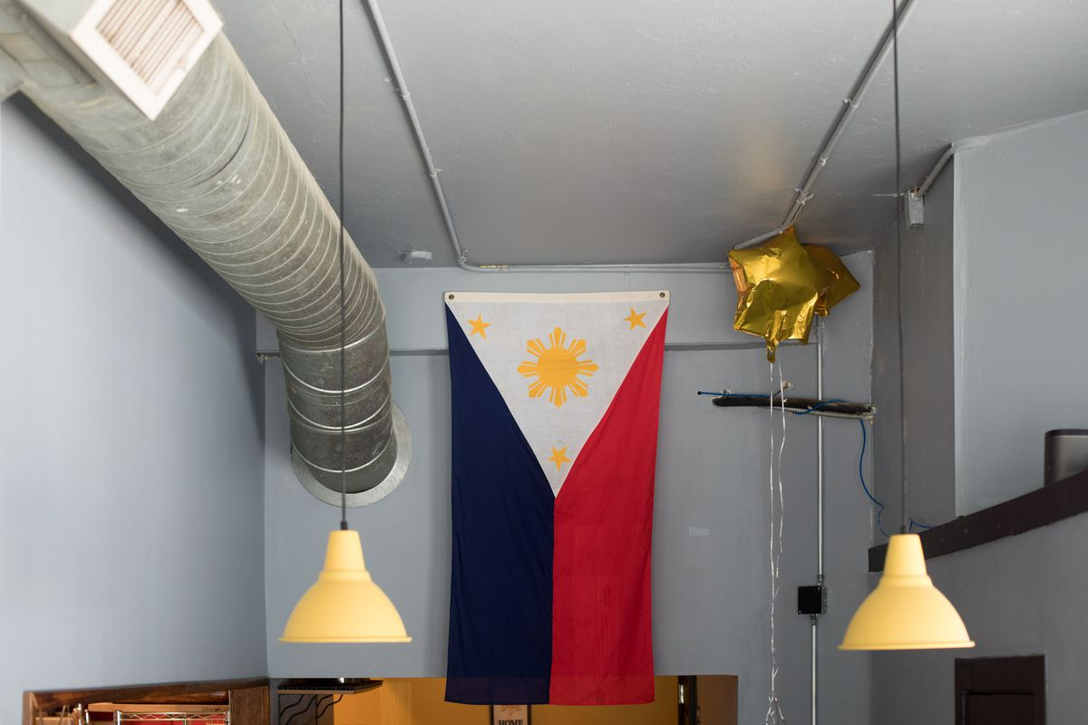 The red, blue, yellow, and white flag belonged to chef Carlo Lamagna's grandfather