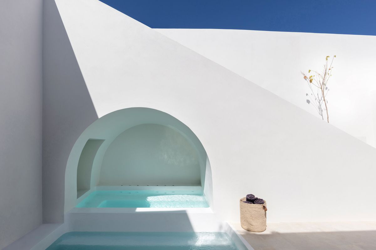 Walled courtyard with pool.