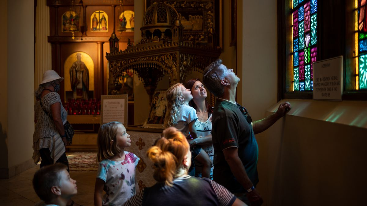 James Wiggins, 10, Audrina Wiggins, 8, Ronda Varney, Trinity Wiggins, 5, Brittney Wiggins and Jeff Varney check out the stained glass windows inside the Holy Trinity Cathedral while attending the Greek Festival in Salt Lake City on Friday, Sept. 10, 2021.