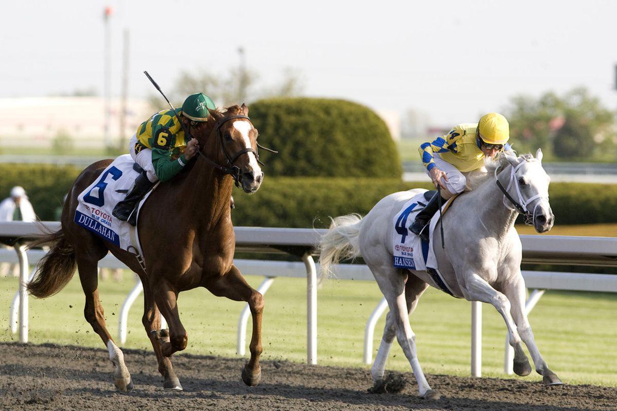 Apr 14, 2012; Lexington, KY, USA; Jockey Kent Desormeaux aboard Dullahan (6) defeats Ramon Dominguez aboard Hansen (4) in the Bluegrass Stakes at Keeneland Race Track. Mandatory Credit: Mark Zerof-US PRESSWIRE