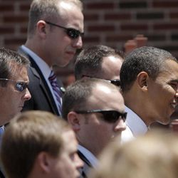 FILE - In this Monday, June 30, 2008 file photo, Secret Service agents surround Democratic presidential candidate Sen. Barack Obama as he greets supporters in Independence, Mo. The Secret Service has been tarnished by a prostitution scandal that erupted April 13, 2012 in Colombia involving 12 Secret Service agents, officers and supervisors and 12 more enlisted military personnel ahead of President Barack Obama's visit there for the Summit of the Americas.