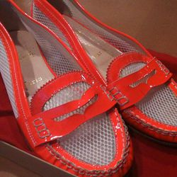 New to this sale: orange patent mesh loafers. $150.