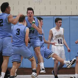 West Jordan players celebrate their overtime win against Taylorsville at Taylorsville High School Tuesday, Jan. 28, 2020.