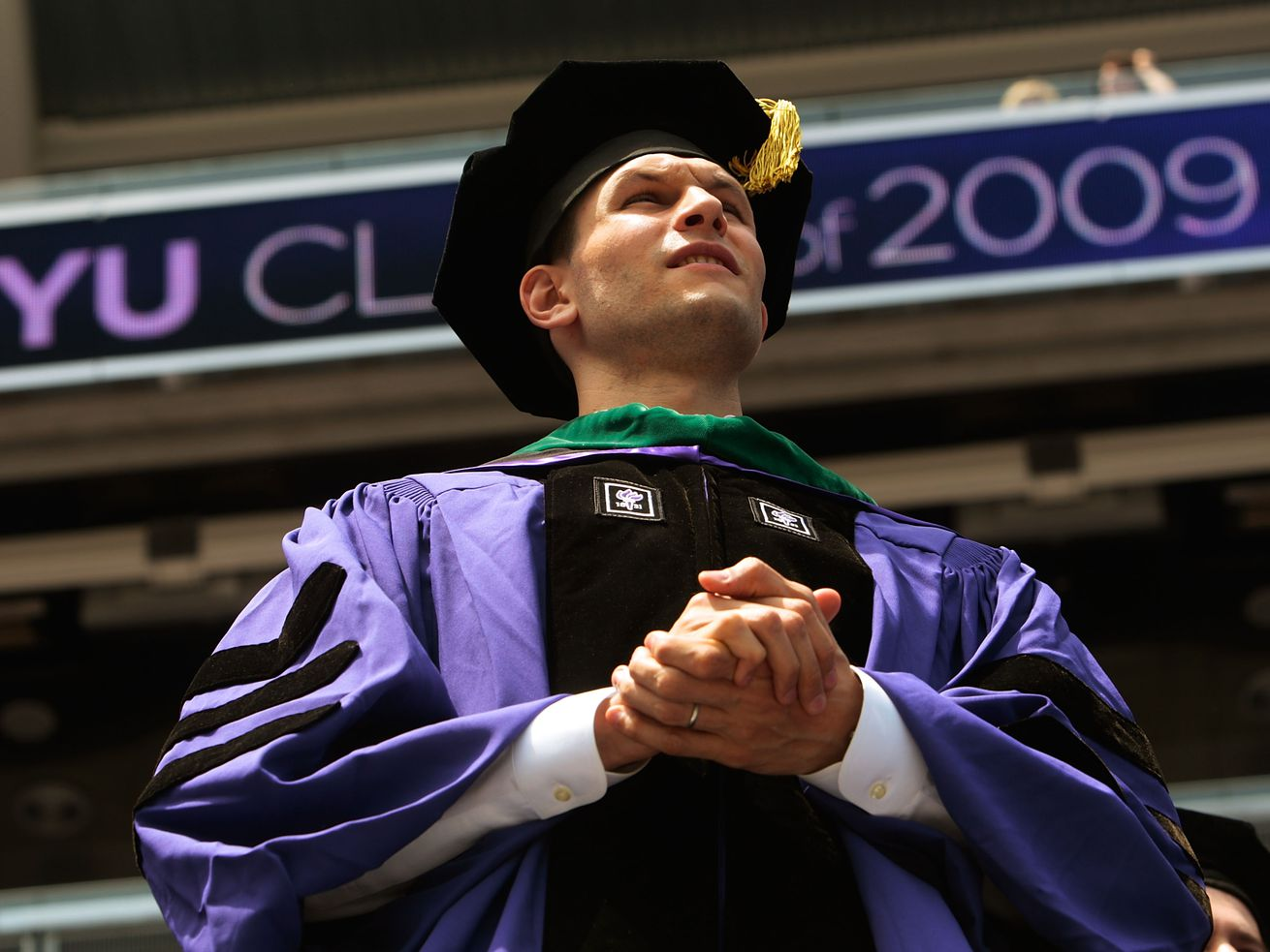 New York University medical school graduate Andrew Michael Goldsweig looks on during the 177th commencement exercises for New York University at Yankee Stadium on May 13, 2009.