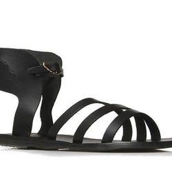 "<b>Ancient Greek Sandals</b> Ikaria Winged Vachetta Flat Sandal, <a href=""http://www.bergdorfgoodman.com/Ancient-Greek-Sandals-Ikaria-Winged-Vachetta-Flat-Sandal-Black/prod87550289_cat10012__/p.prod?icid=&searchType=EndecaDrivenCat&rte=%252Fcategory.servi"