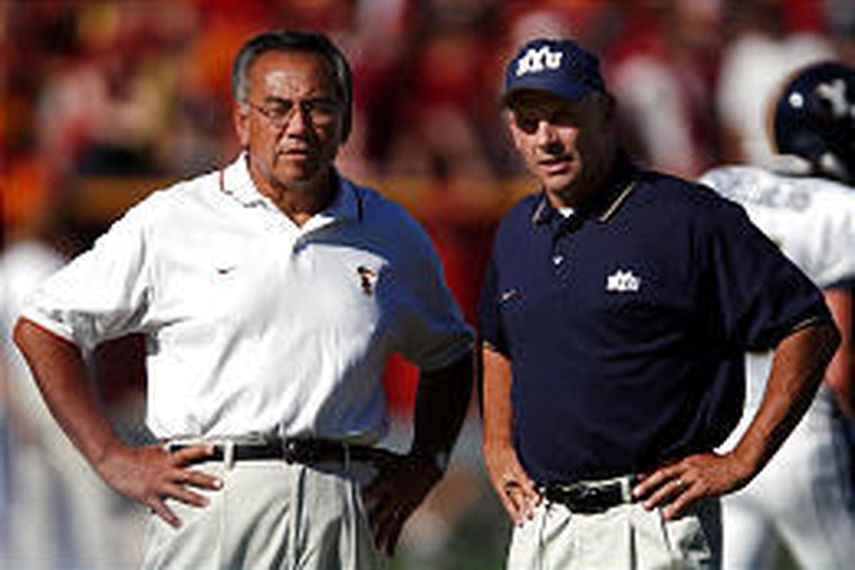 USC offensive coordinator Norm Chow and BYU coach Gary Crowton chat before Saturday's contest.