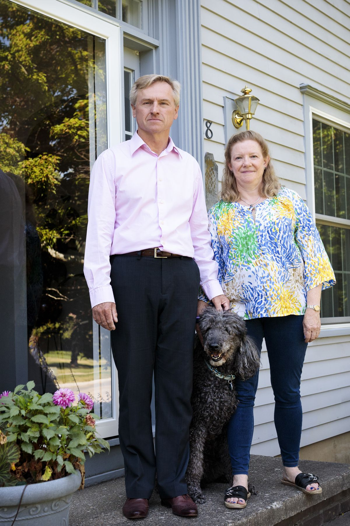 Tim and Kim Blake in front of their home in South Burlington, Vermont, on August 29, 2019.