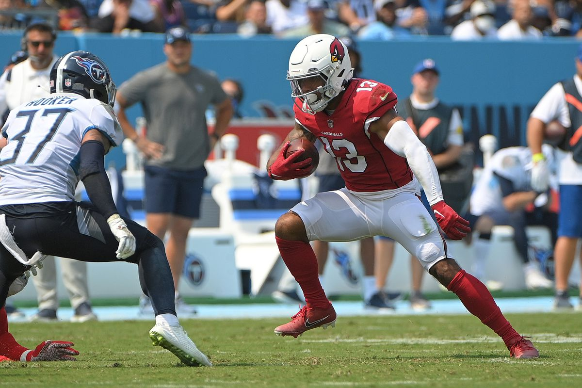 Arizona Cardinals wide receiver Christian Kirk (13) runs the ball after a catch against the Tennessee Titans during the first half at Nissan Stadium.