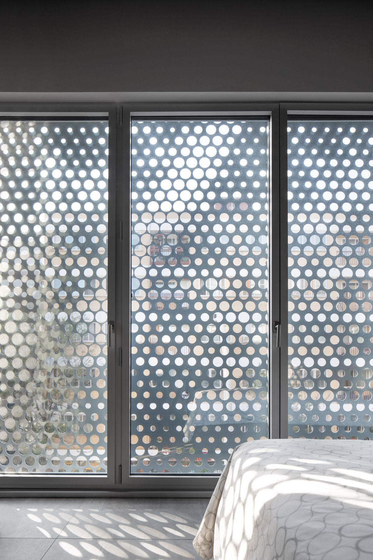 Perforated screen in the bedroom.
