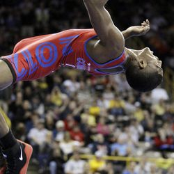 Ellis Coleman performs a back flip after defeating Joe Betterman in their 60-kilogram Greco-Roman finals match at the U.S. Olympic Wrestling Team Trials, Sunday, April 22, 2012, in Iowa City, Iowa.