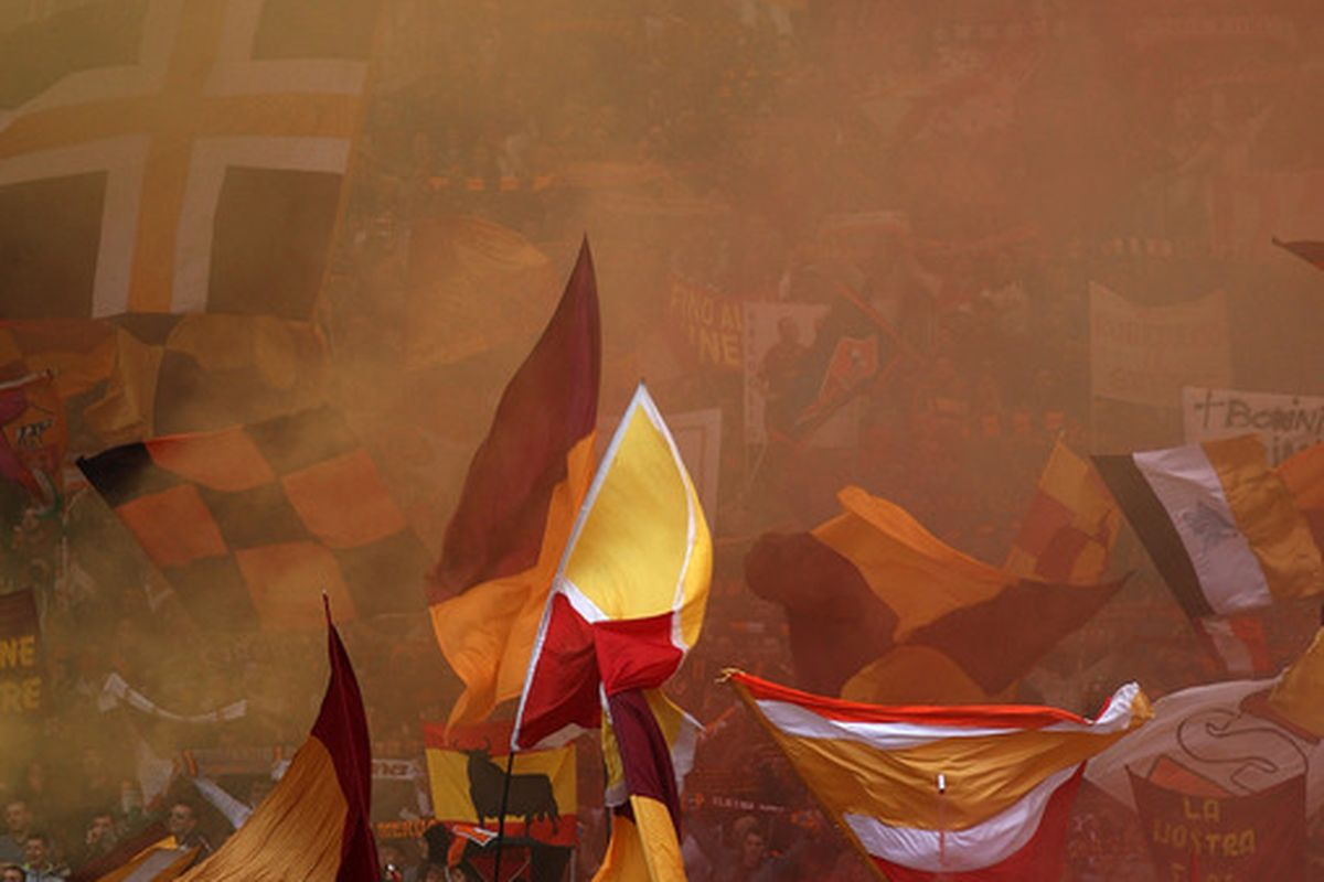 ROME, ITALY - MARCH 04:  Fans of AS Roma support their team during the Serie A match between AS Roma and SS Lazio at Stadio Olimpico on March 4, 2012 in Rome, Italy.  (Photo by Paolo Bruno/Getty Images)
