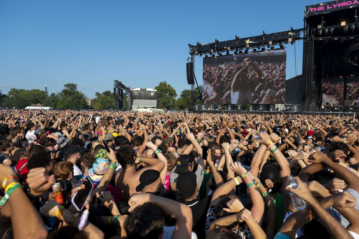 A huge outdoor music festival filled with people