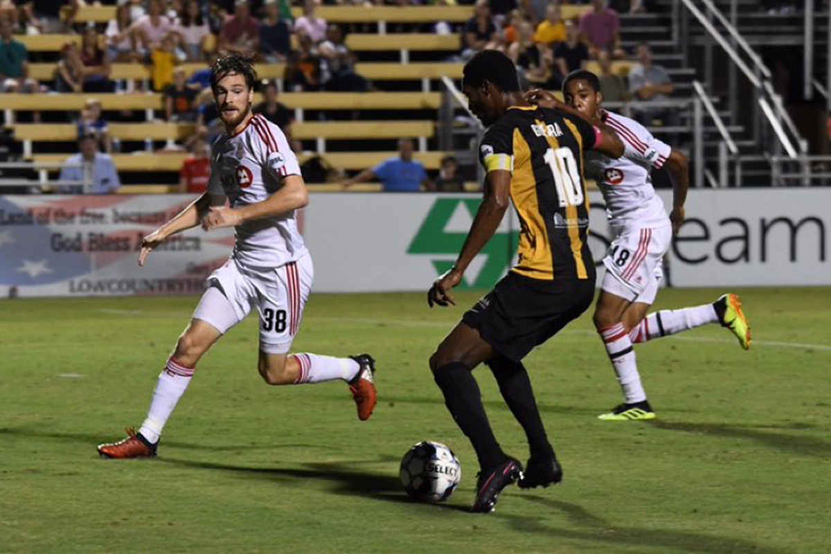 USL Photo - TFC II's Kyle Bjornethun & Dante Campbell help to key the Charleston Battery attack at bay in a 2-1 road win