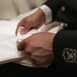 A waiter folds napkins for a luncheon at New York's St. Regis Hotel, Wednesday, March 14, 2012. A century after the Titanic sank, the legacy of the ship's wealthiest and most famous passenger, John Jacob Astor, quietly lives on at the luxury hotel he built in New York City.
