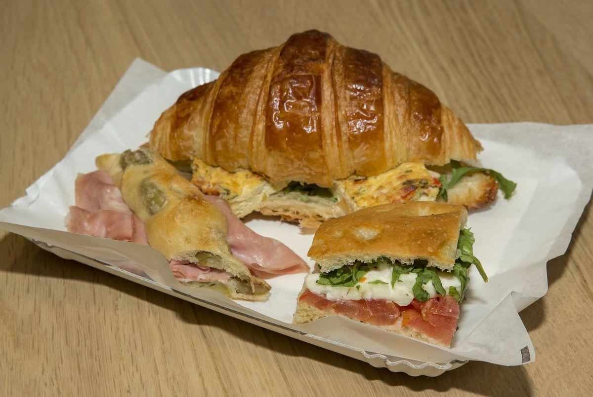 A tray with three Italian sandwiches.
