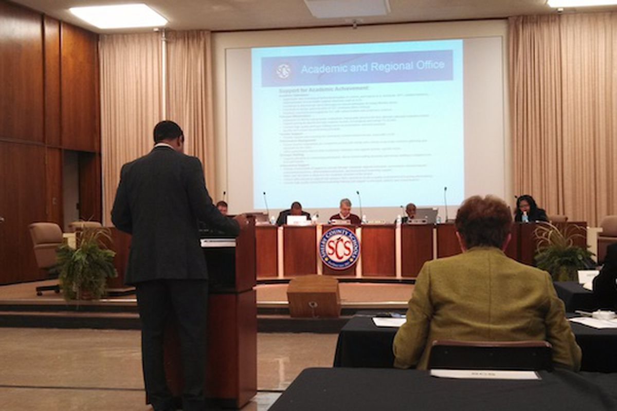 SCS Chief Academic Officer Roderick Richmond presents his department's plans for budget cuts and spending.