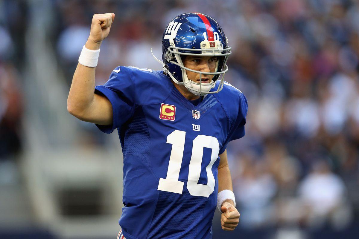 Eli Manning celebrates a Giants' touchdown on Sunday.