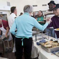 Pamela Atkinson speaks with Joe as Ed Snoddy and other volunteers serve Thanksgiving dinner to the residents of Grace Mary Manor in South Salt Lake on Tuesday, Nov. 22, 2016. Snoddy spent days making enough turkey, stuffing and side dishes for the 110 residents of Grace Mary.