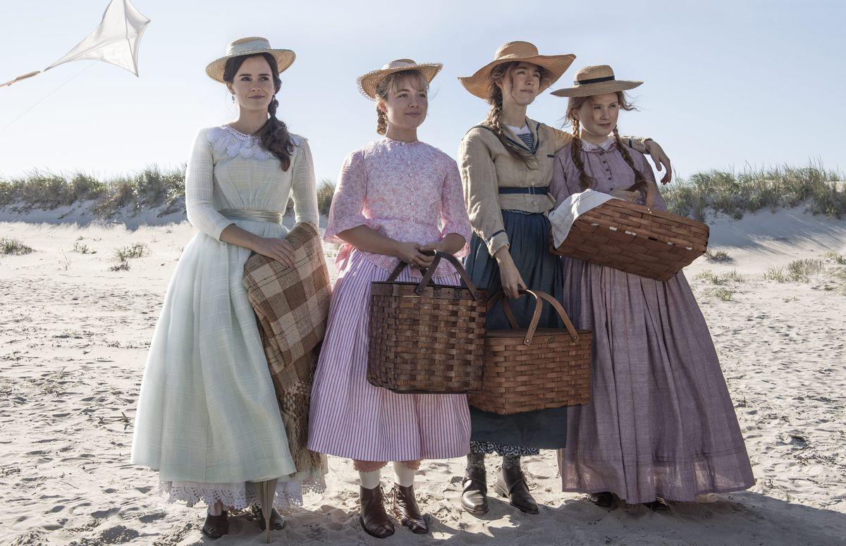 Meg (Emma Watson), Amy (Florence Pugh), Jo (Saoirse Ronan), and Beth (Eliza Scanlen) on the beach in 2019's Little Women