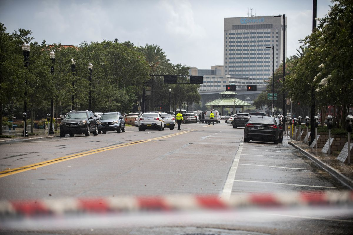 Police barricade a street near the Jacksonville Landing in Jacksonville, Florida on Sunday, August 26, 2018.A shooter opened fire on a video game tournament there.