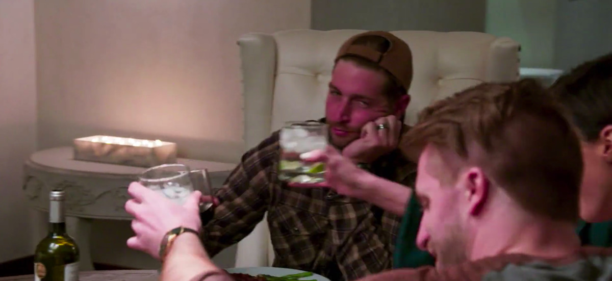 Jay Cutler looking bored as he raises his glass to cheers