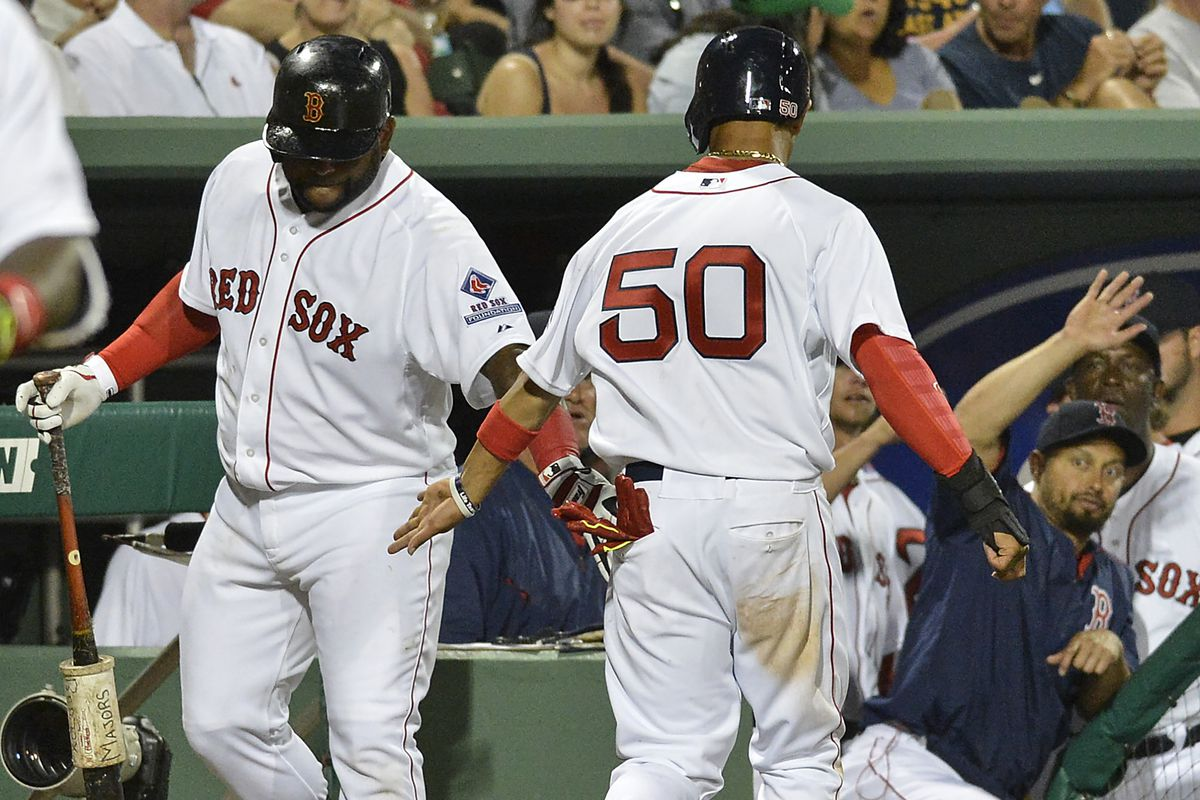 Pablo Sandoval and Mookie Betts, seen here slapping hands in spring training, are in two of my bold predictions