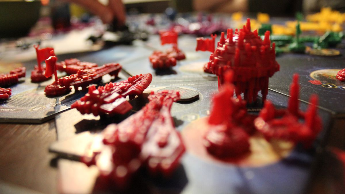 Red ships on the board for a game of Twilight Imperium.