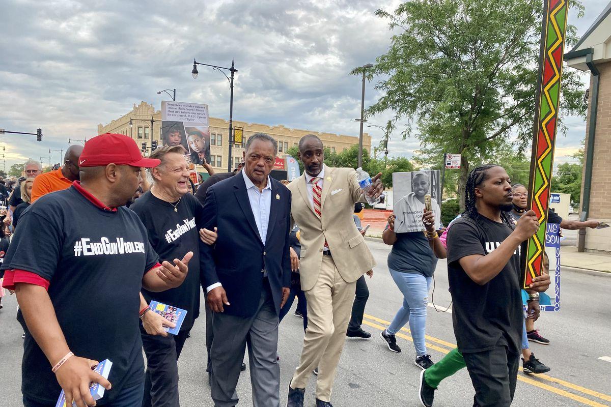Rev. Jesse Jackson Sr. walks with Rev. Michael Pfleger at the St. Sabina Peace Walk on Friday, June 25, 2021.