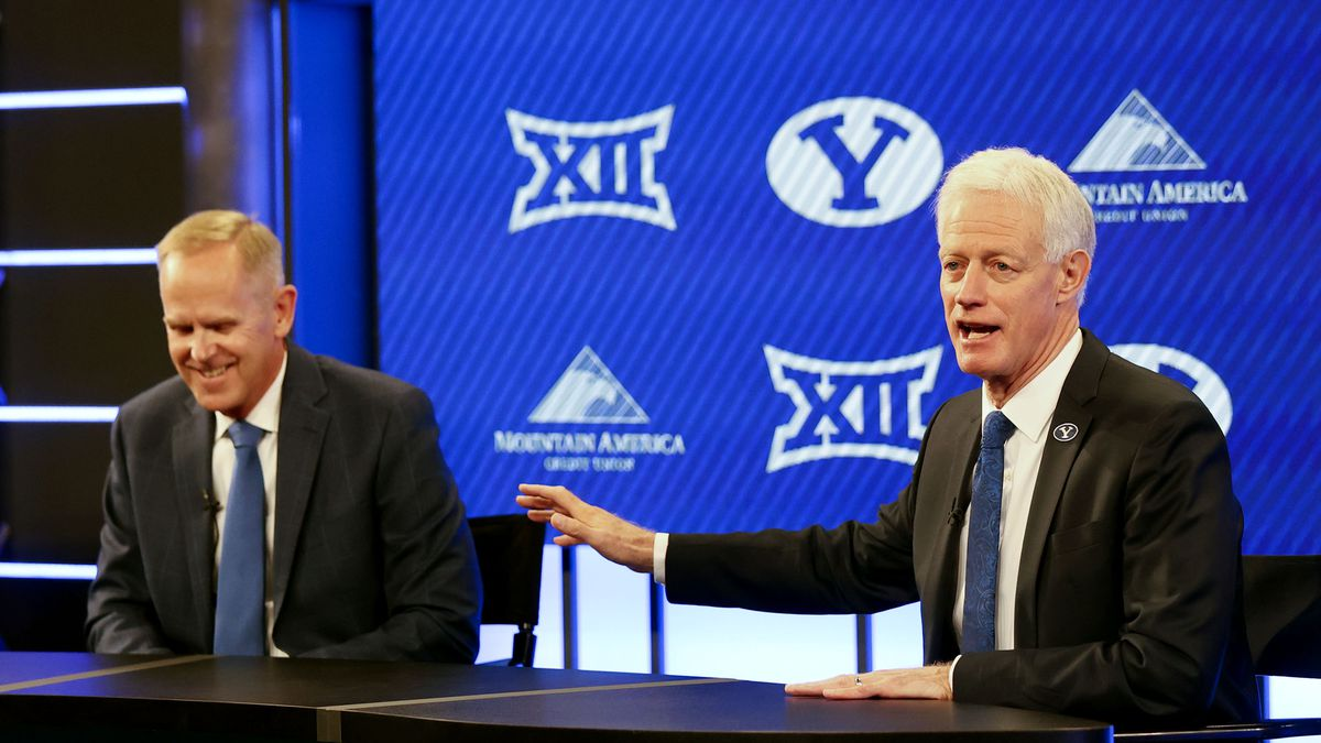 BYU president Kevin Worthen, right, speaks about athletic director Tom Holmoe, left, during a press conference announcing that BYU has accepted an invitation to the Big 12 Conference at BYU in Provo on Friday, Sept. 10, 2021. BYU will play all sports provided by the Big 12 except for equestrian, rowing and wrestling. Men's volleyball will continue to play in the Mountain Pacific Sports Federation, as the Big 12 does not offer the sport.