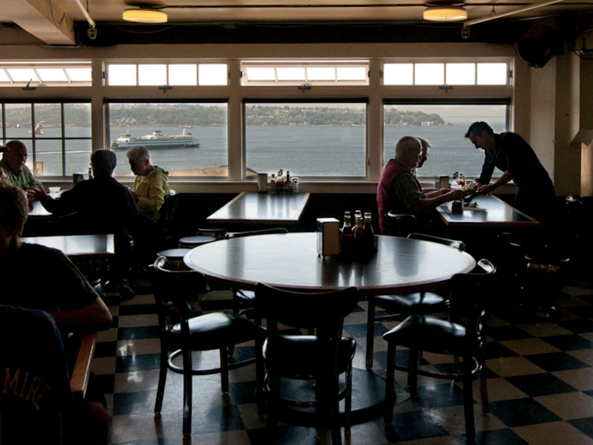 A view of the Puget Sound from Lowell's Restaurant, with a few customers sitting at tables inside.