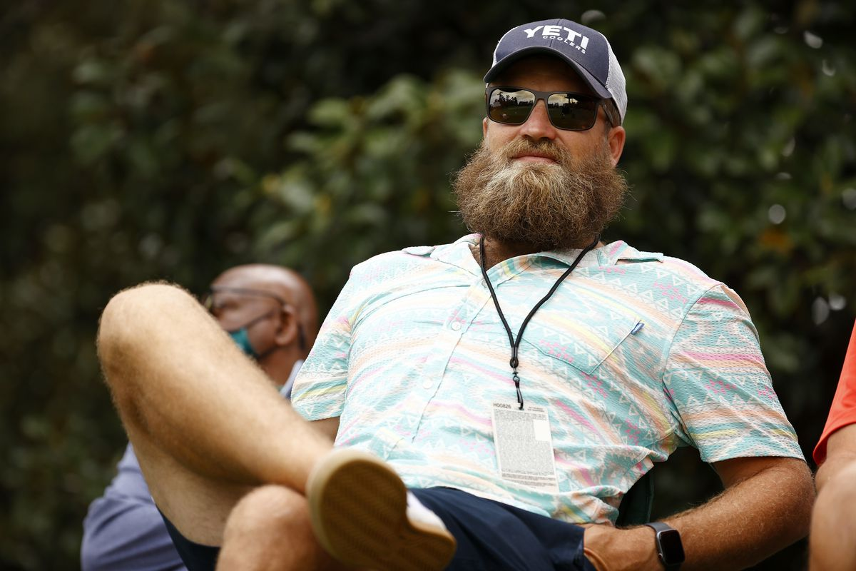 Ryan Fitzpatrick of the Washington Football Team watches play on the eighth green during the second round of the Masters at Augusta National Golf Club on April 09, 2021 in Augusta, Georgia.