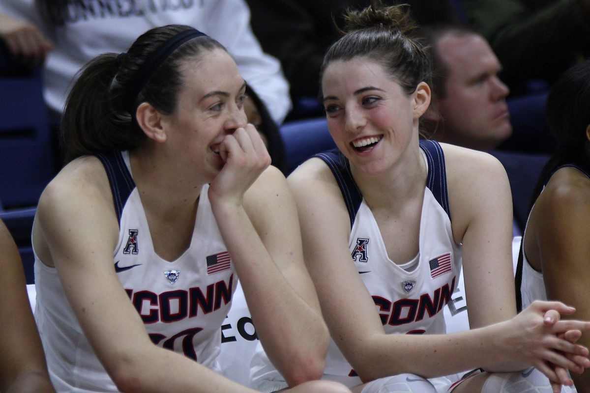 Breanna Stewart and Katie Lou Samuelson share a laugh, probably after looking at the scoreboard.