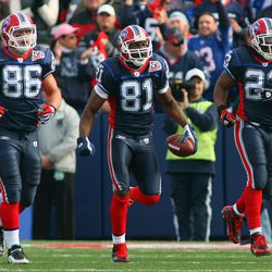 Derek Fine #86, Terrell Owens #81 and Marshawn Lynch #23 of the Buffalo Bills celebrate during the game against the Houston Texans at Ralph Wilson Stadium on November 1, 2009 in Orchard Park, New York
